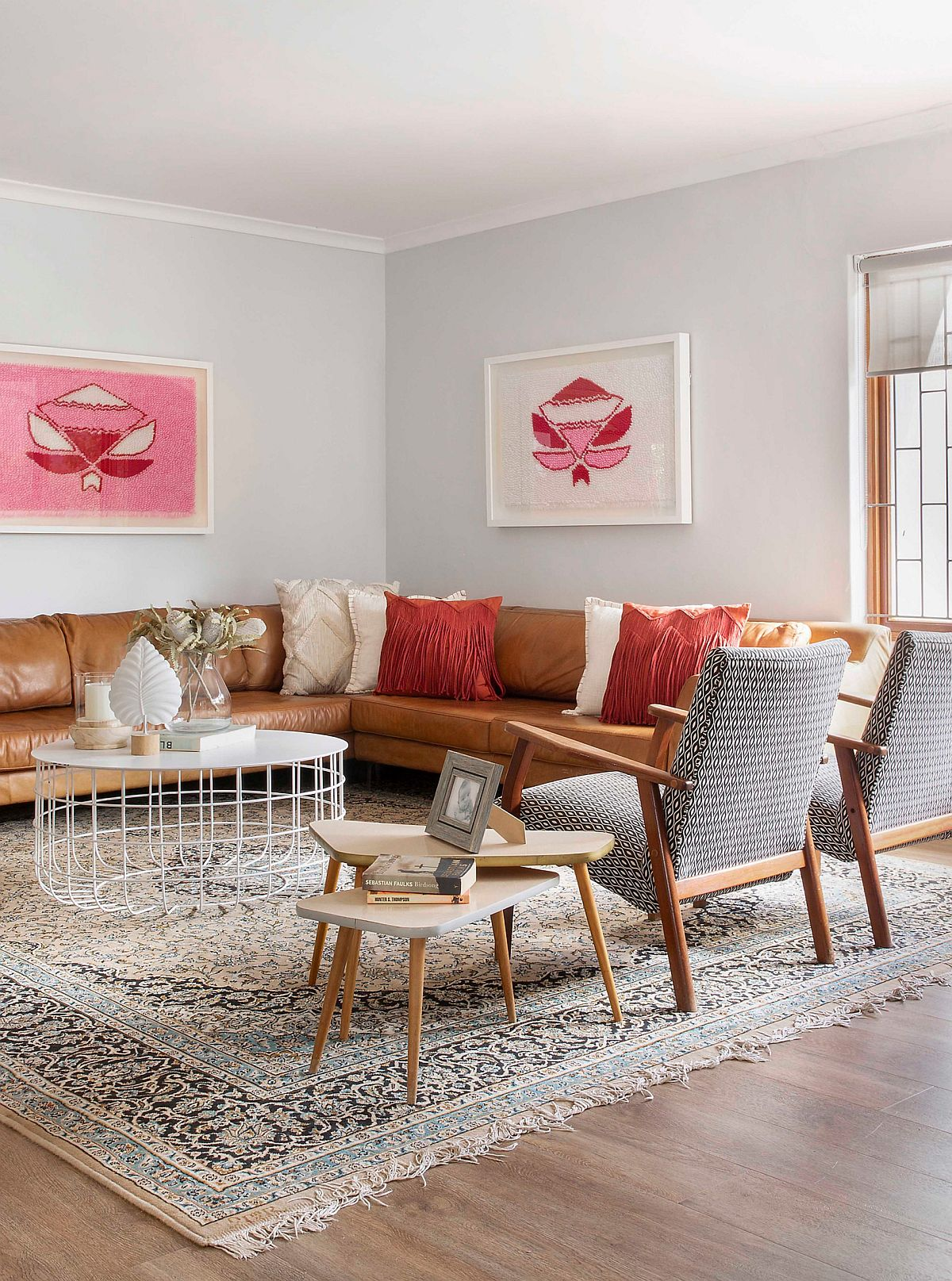 Accent pillows in orange and cream give the room a balanced look