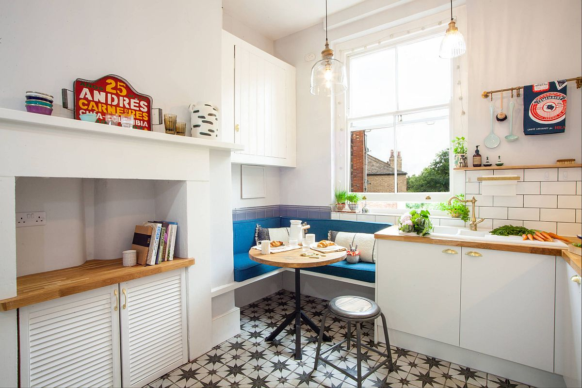 Banquette-seating-in-blue-inside-the-small-eclectic-kitchen-adds-color-while-utilizing-corner-space-52068