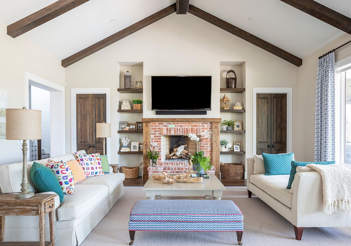 Beautiful accent pillows bring different colors and patterns to the modern industrial living room