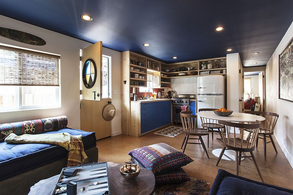 Beautiful blue ceiling, custom wooden decor and space-savvy design shape the trailer house