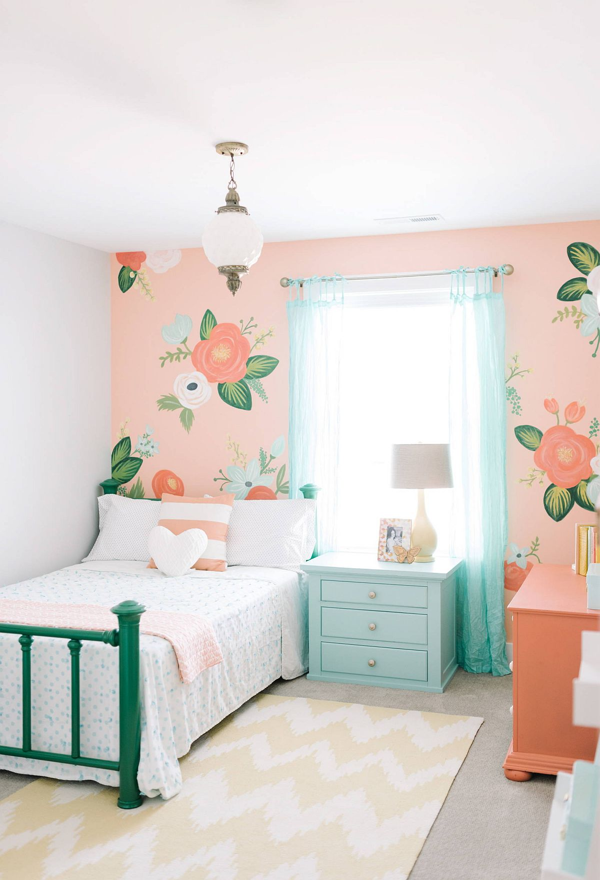 Beautiful floral wallpaper in pink steals the show in this small kids' bedroom