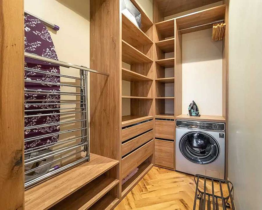 Beautiful-laundry-room-in-wood-and-white-inside-the-small-Tbilisi-apartment-92527