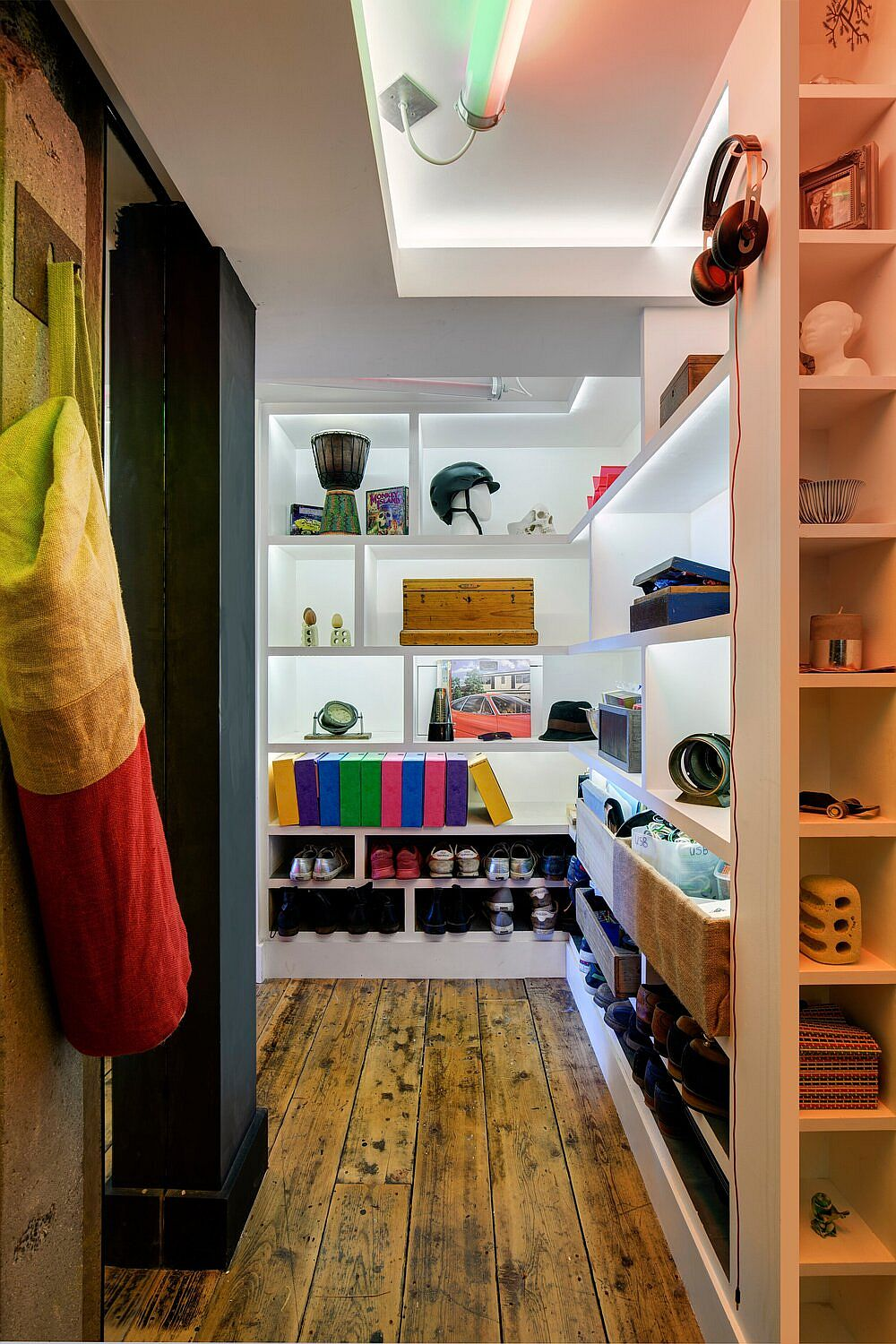 Beautifully lit closet also is used as a lovely decorative element inside the apartment