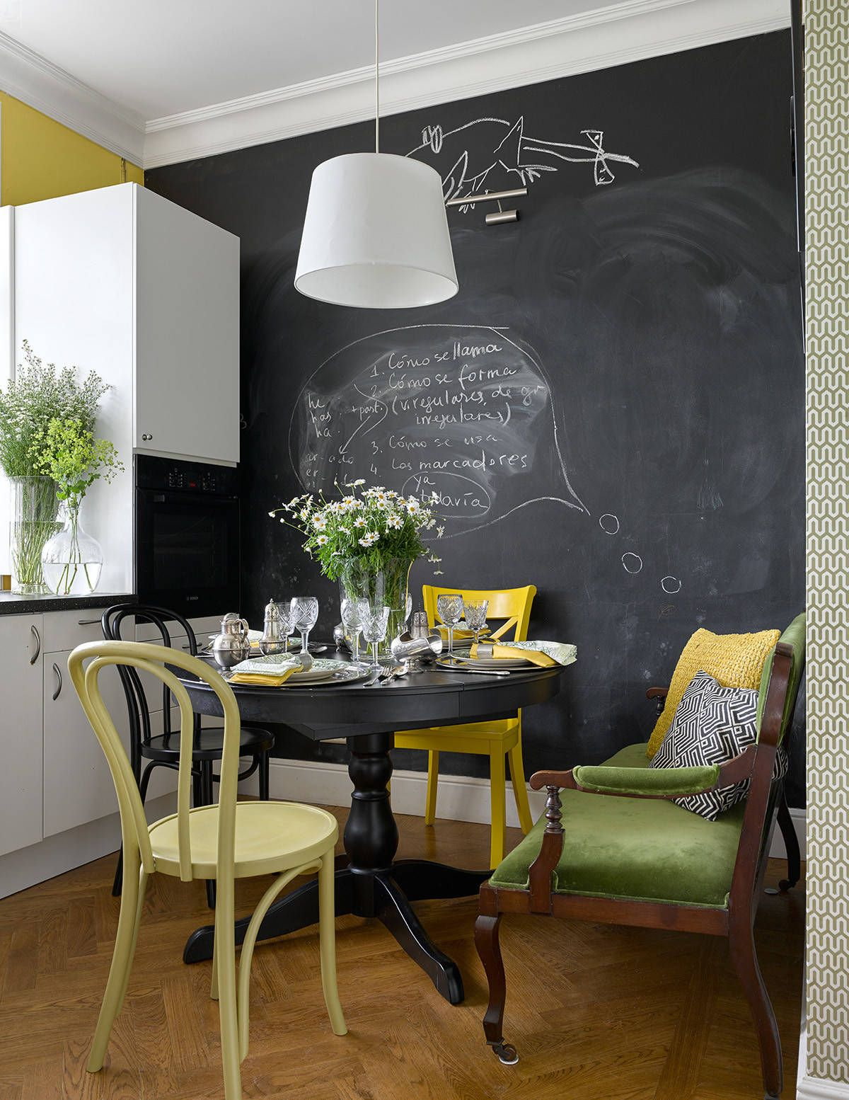 Black-chalkboard-wall-and-gorgeous-yellow-chair-for-the-small-eat-in-kitchen-92917