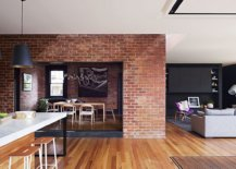 Brick-wall-sections-coupled-with-wooden-flooring-inside-the-heritage-Aussie-home-43074-217x155