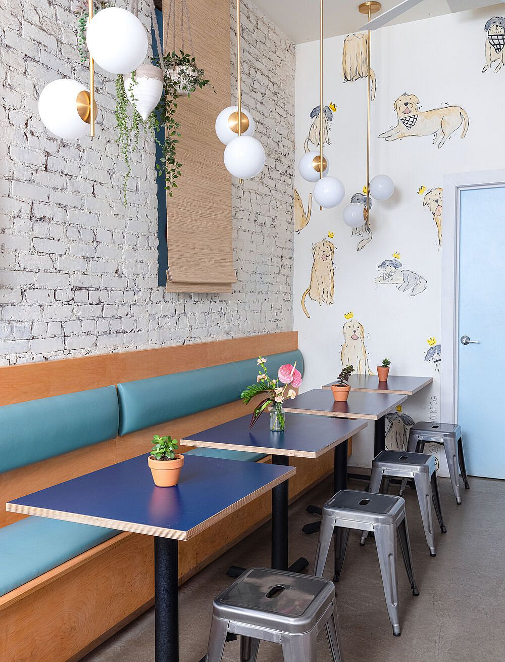 Brick walls that are whitewashed give the restaurant interior a cozy, timeless appeal