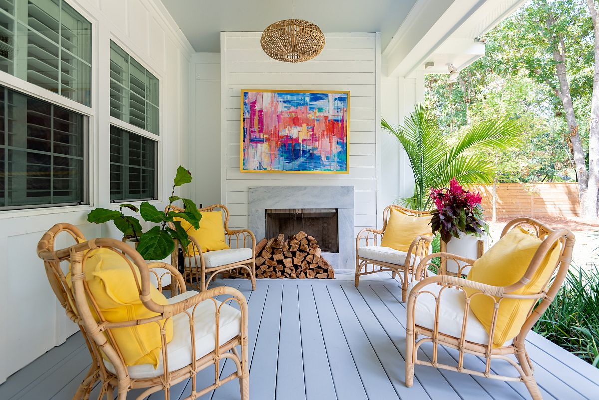 Bright cushions in yellow bring color to this relaxing modern porch in white