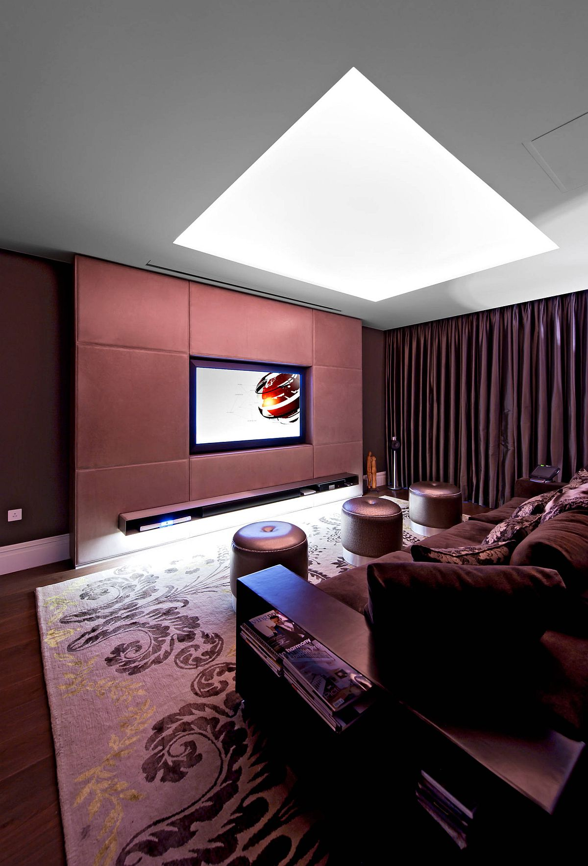 Brightly colored walls in the small contemporary home theater with ample lighting are a rare fetaure
