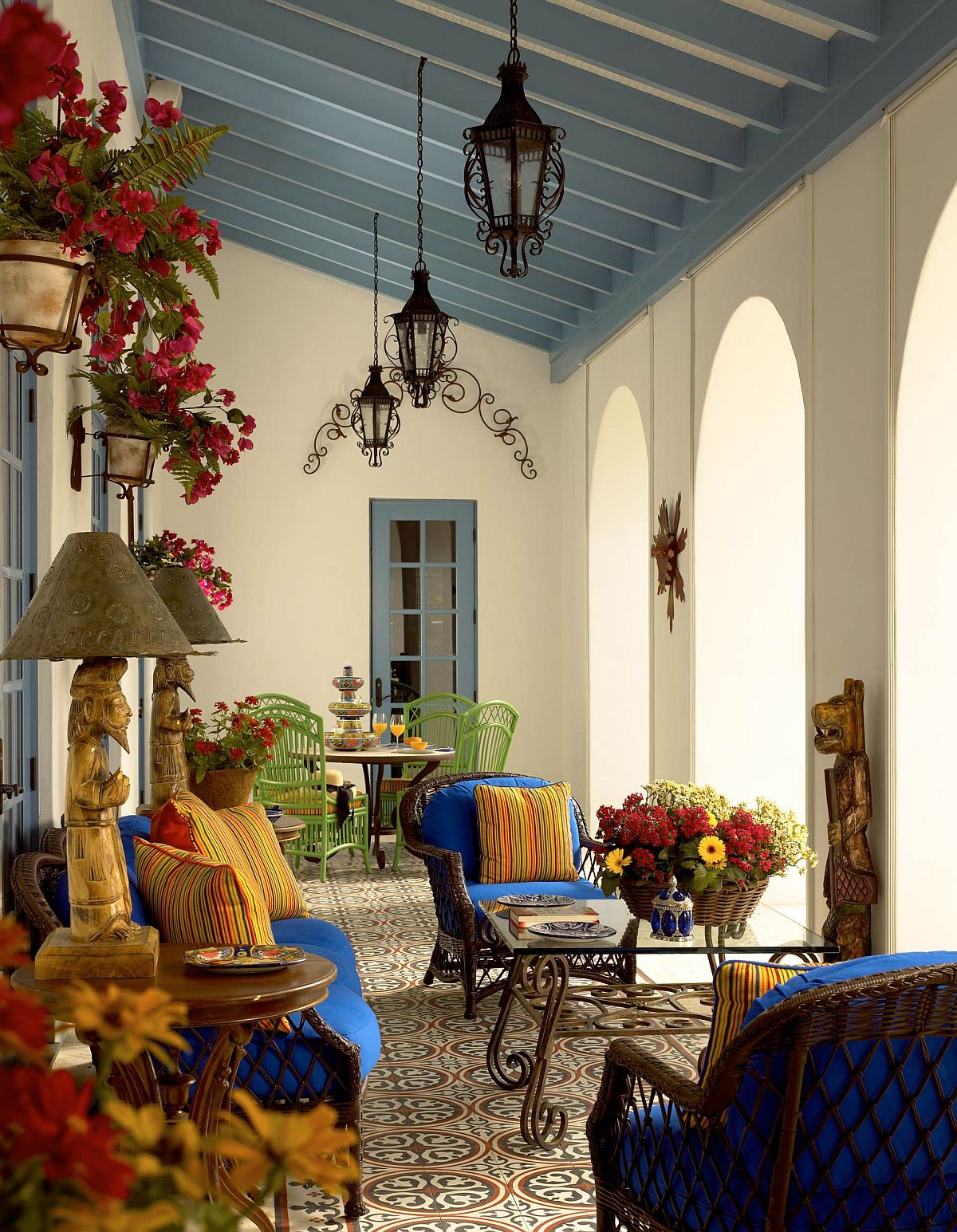 Brilliant blues and bold yellows are coupled with a relaxing ambiance inside this Mediterranean porch