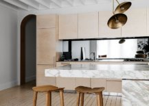 Calacatta-marble-counters-steal-the-spotlight-in-this-polished-kitchen-with-a-lovely-breakfast-bar-46611-217x155