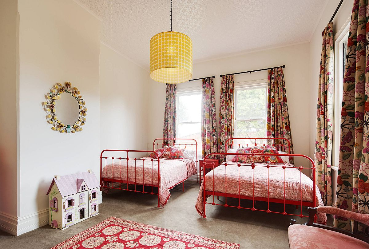 Concrete floors combined with colorful accents and metal beds in the lovely bedroom