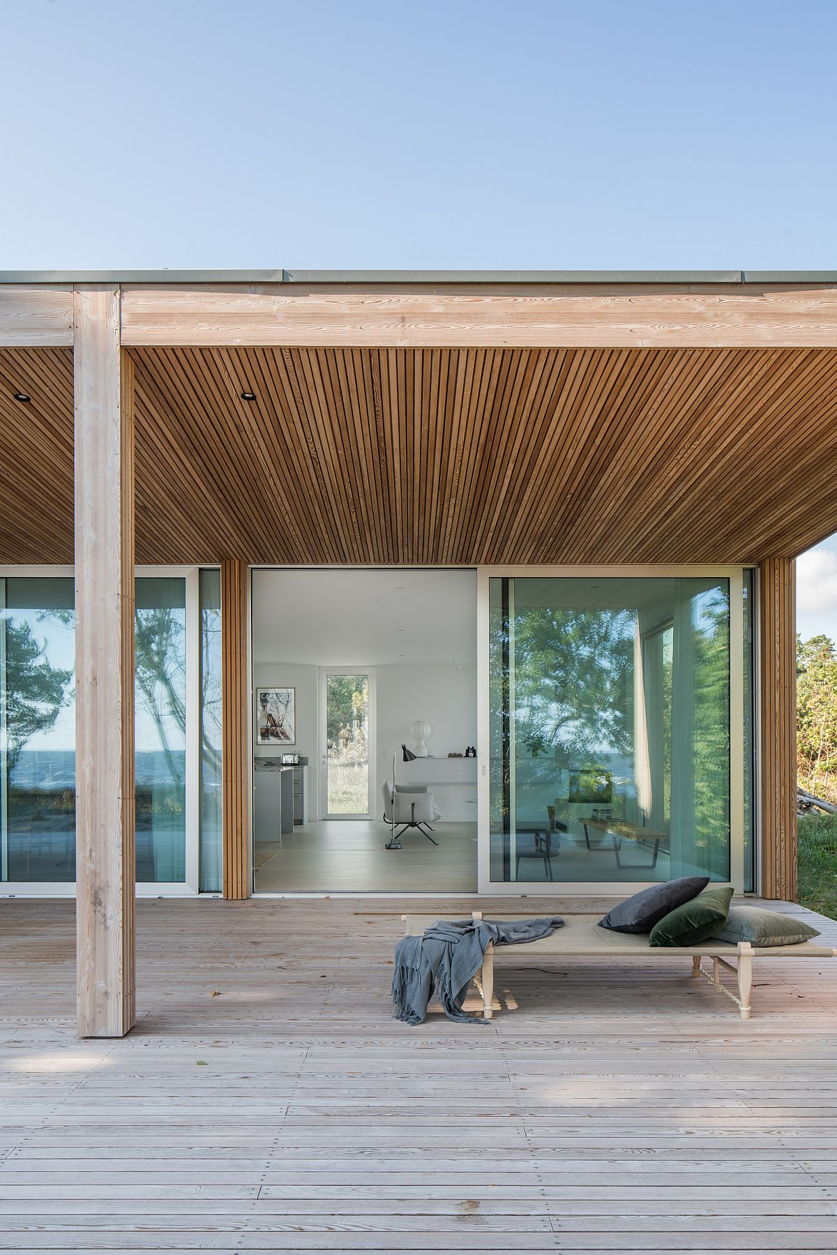 Custom larch panelling gives the cozy summer house a warm and welcoming look