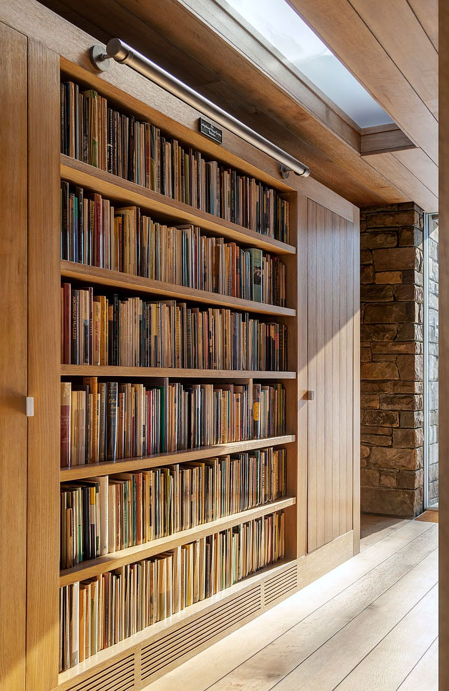 Custom wooden bookshelves for the large collection of books inside the Writer's Studio
