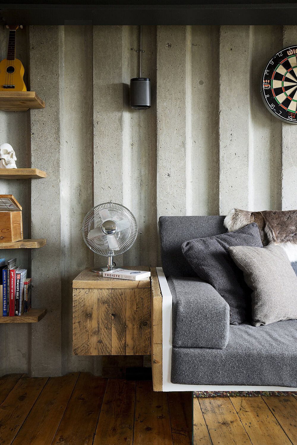 Custom wooden side table next to the sofa saves space