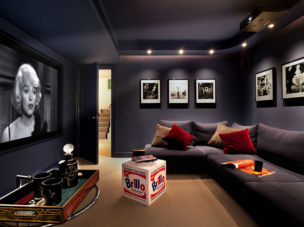 Dark gray walls and couch in matching hues create a lovely contemporary home theater