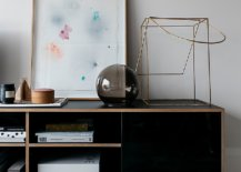 Decorating-the-beautiful-black-credenza-in-wood-in-the-living-room-with-sculptural-and-artistic-pieces-13937-217x155
