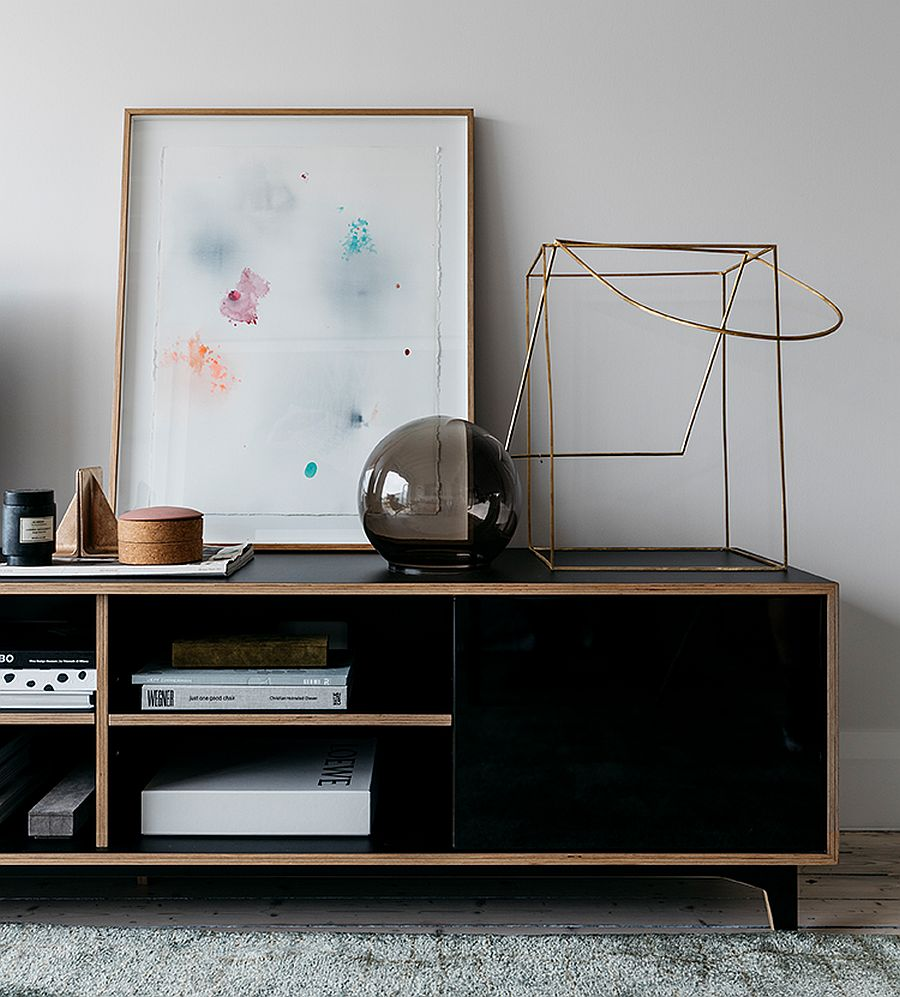 Decorating-the-beautiful-black-credenza-in-wood-in-the-living-room-with-sculptural-and-artistic-pieces-13937