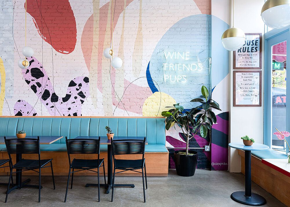 Delightful pops of color and neon lighting bring brightness to the rejuvinated NYC cafe interior