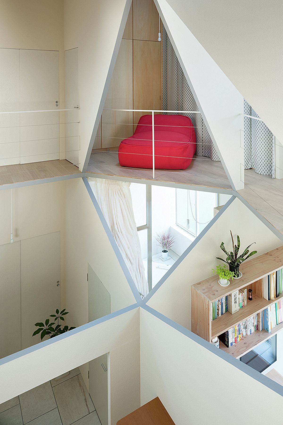 Different cut-outs and spaces create tiny rooms inside the house with geometric style