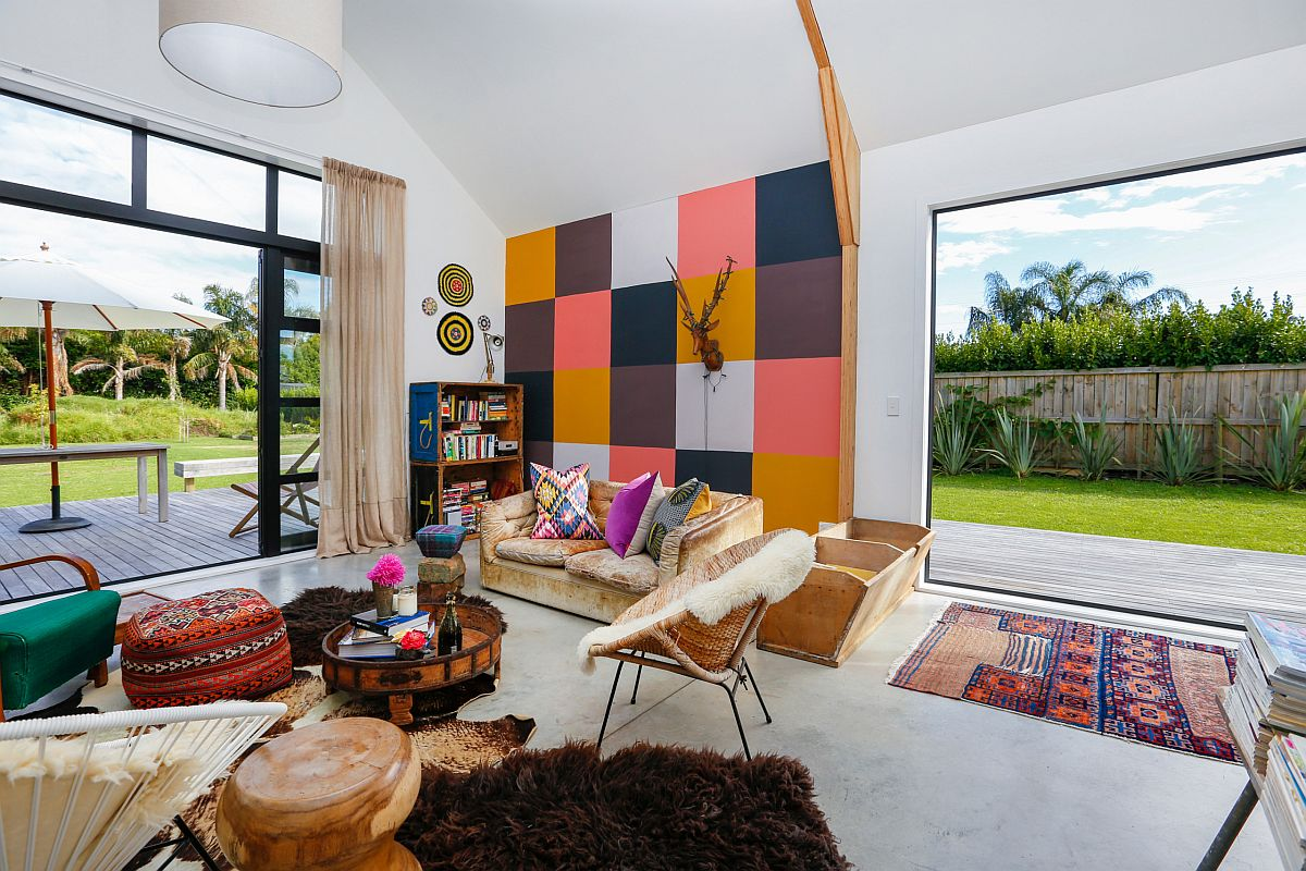 Eclectic blend of colors in the living room with modern backdrop