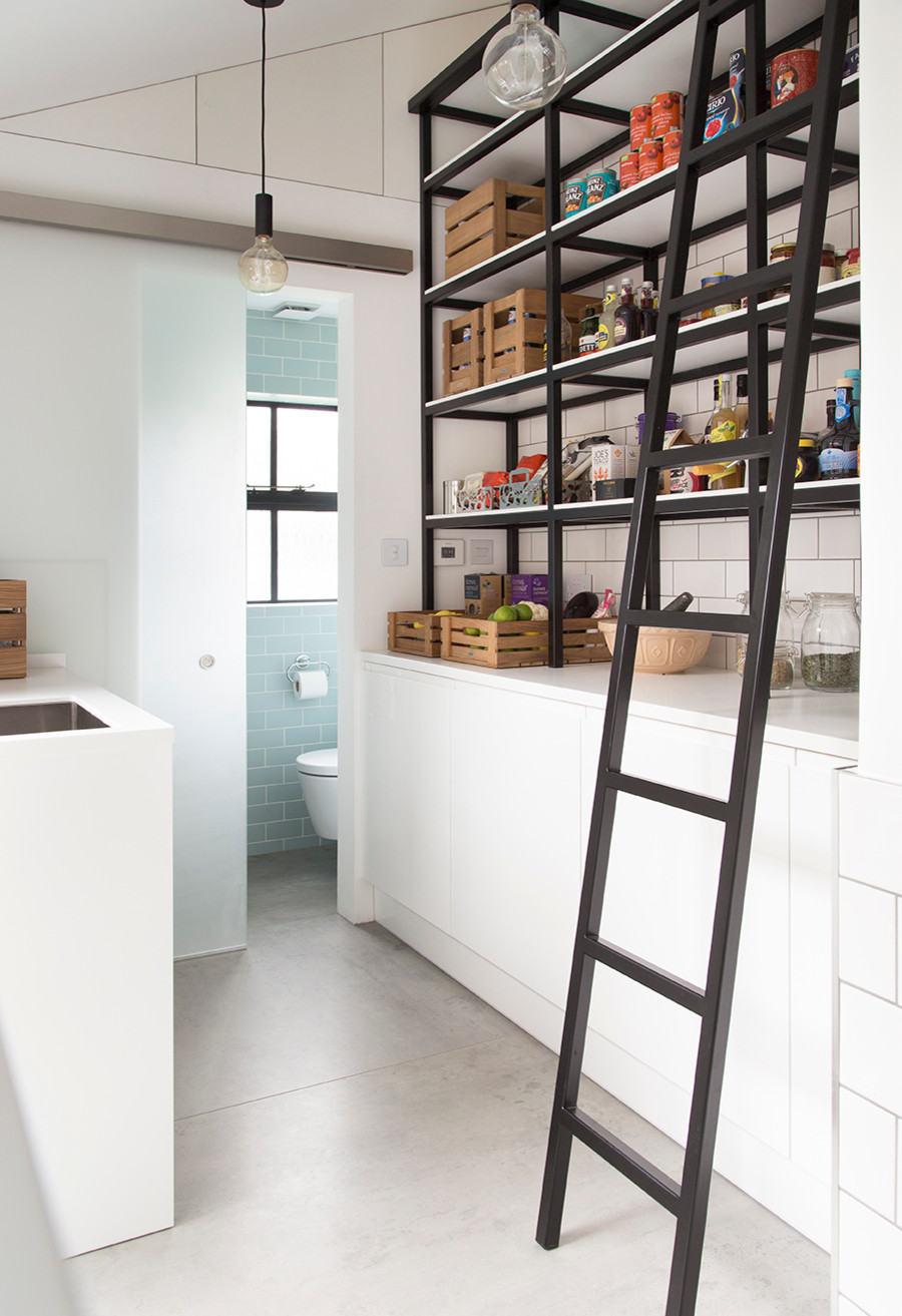 Edison bulb lighting for the industrial styled pantry with simple shelving
