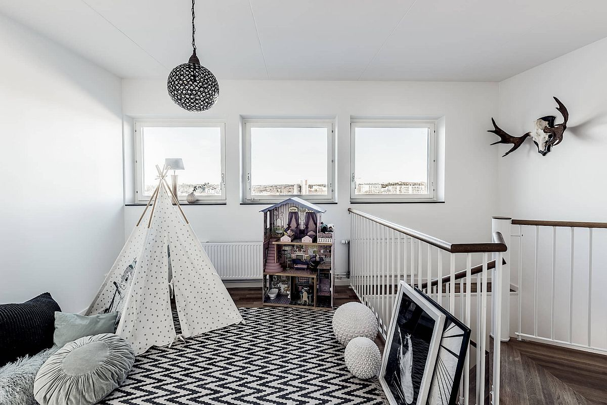 Fabulous-gender-neutral-kids-playroom-with-Scandinavian-style-in-black-and-white-sits-in-the-staircase-landing-area-47716