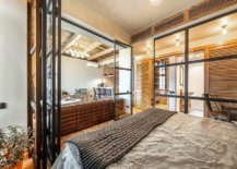 Framed-glass-walls-surround-the-bedroom-and-separate-it-from-the-living-area-57328-217x155