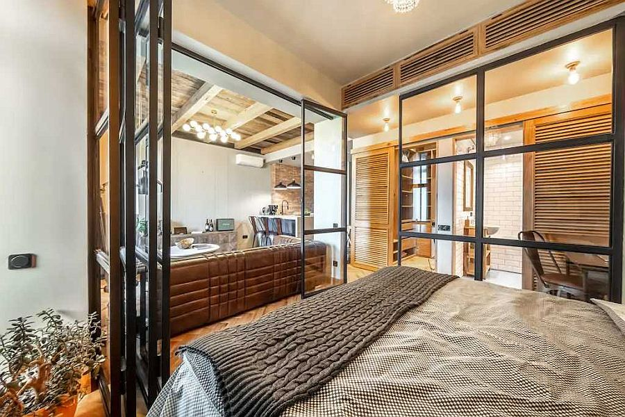 Framed-glass-walls-surround-the-bedroom-and-separate-it-from-the-living-area-57328
