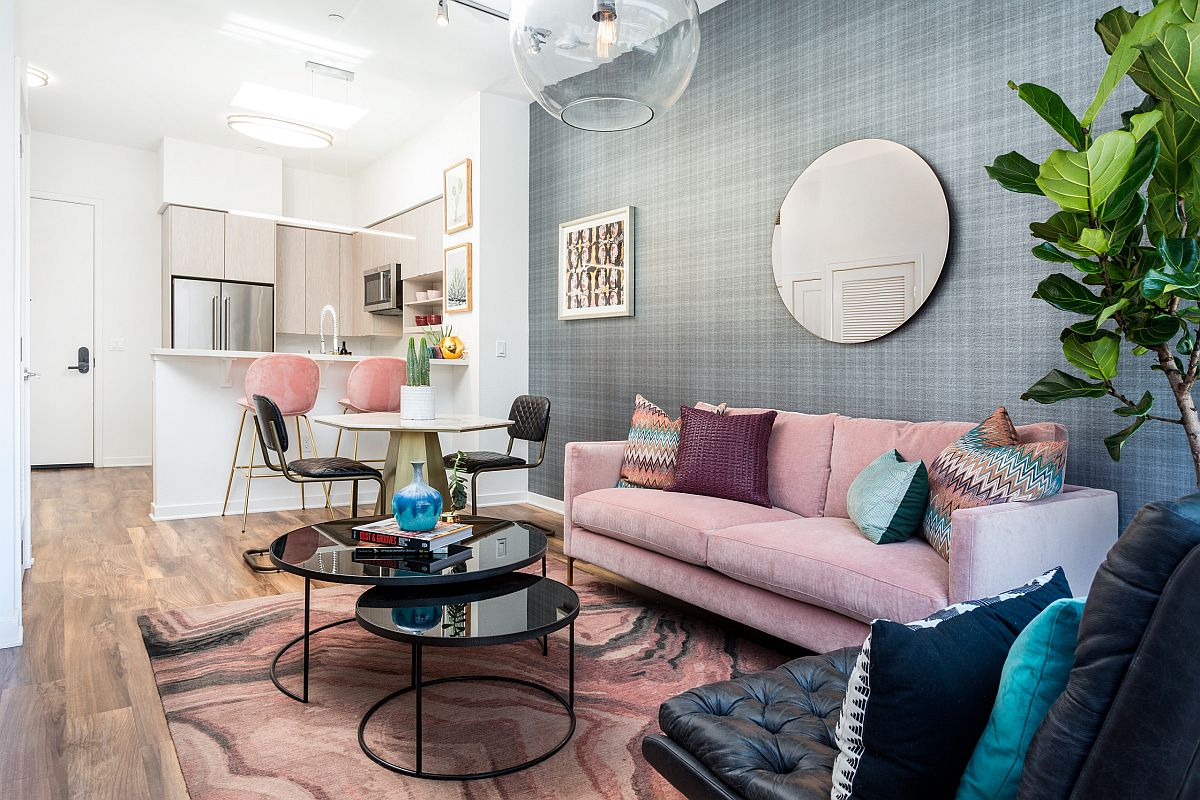Gorgeous pink and gray living room with multi-colored accent pillows