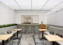 Gray-and-white-are-coupled-with-splashes-of-greenery-and-concrete-inside-the-restaurant-29851-217x155