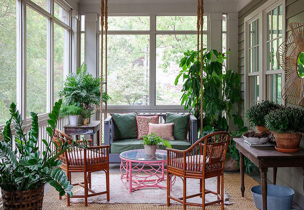 Greenery brings a relaxing vibe to the stylish and space-savvy porch