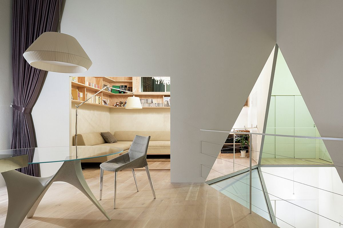 Hexagonal atrium design also brings geometric style to various rooms of the house