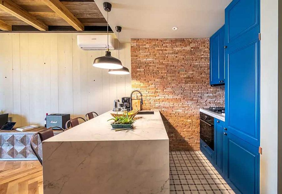 Kitchen-at-the-end-of-the-living-area-with-a-splash-of-blue-thrown-into-mix-56766
