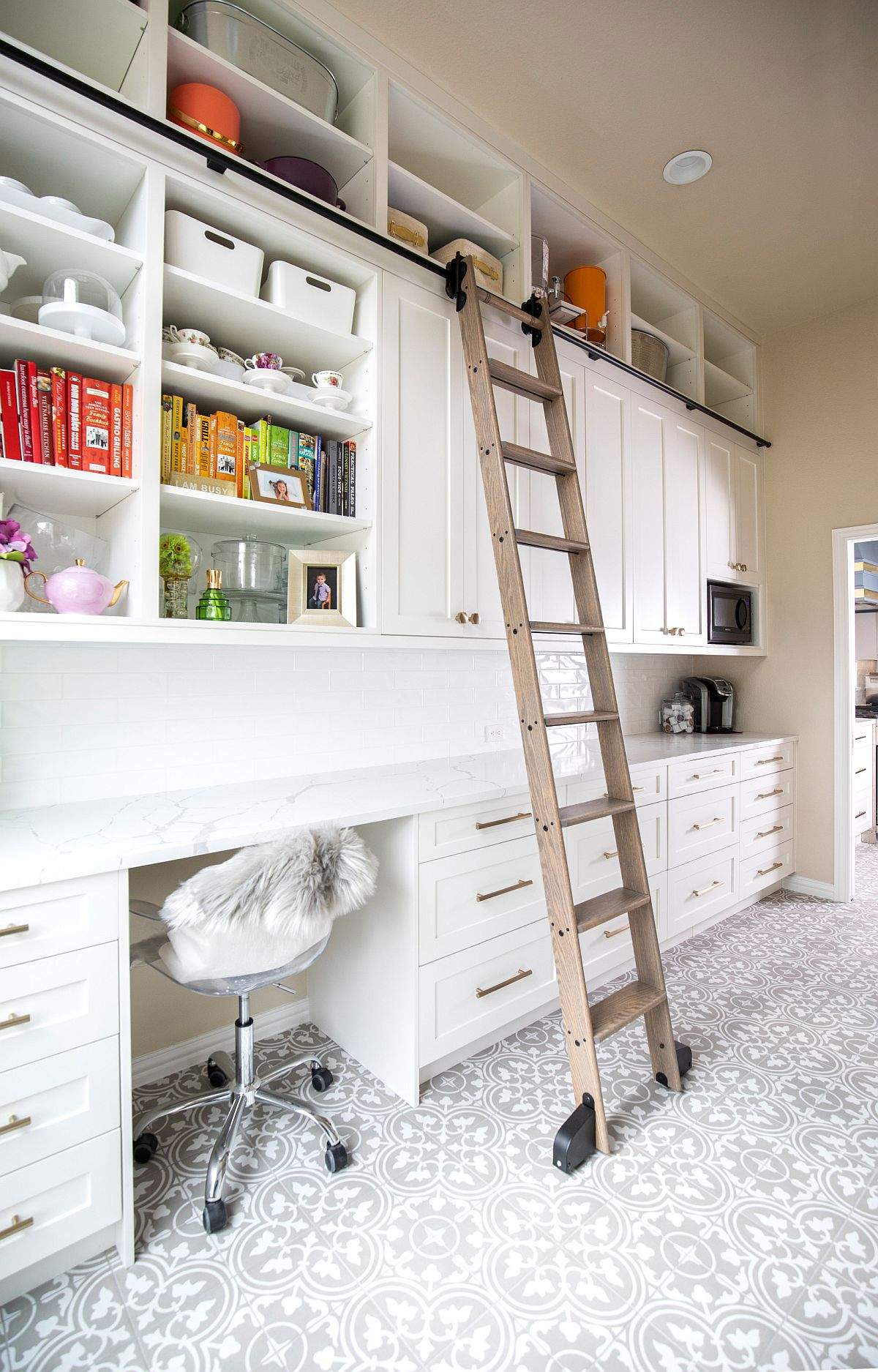 Kitchen offers ample space to create a home workstation by pulling up a chair