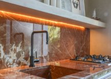LED-strip-lights-under-the-counter-add-glow-to-the-backsplash-in-stone-47499-217x155