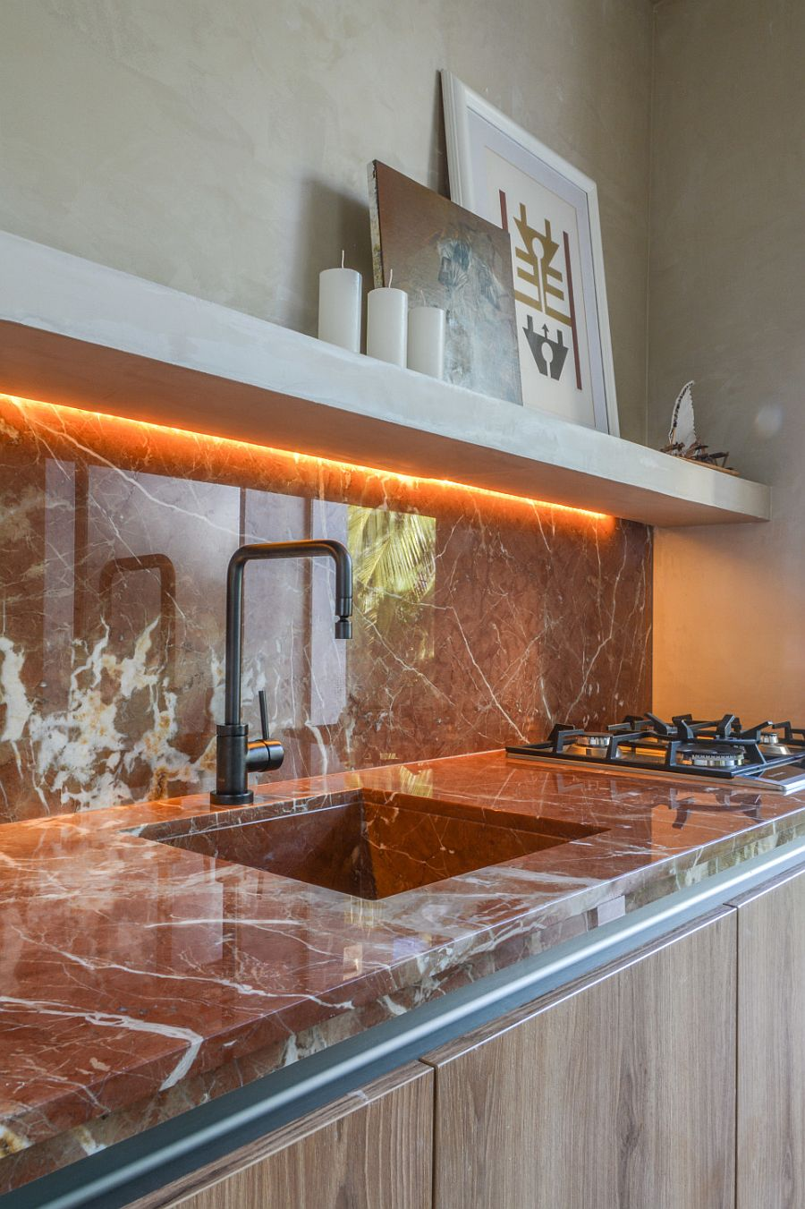LED strip lights under the counter add glow to the backsplash in stone