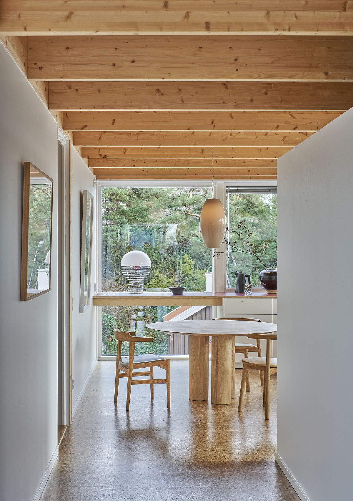 Light-filled and cheerful white and wood interior of the house