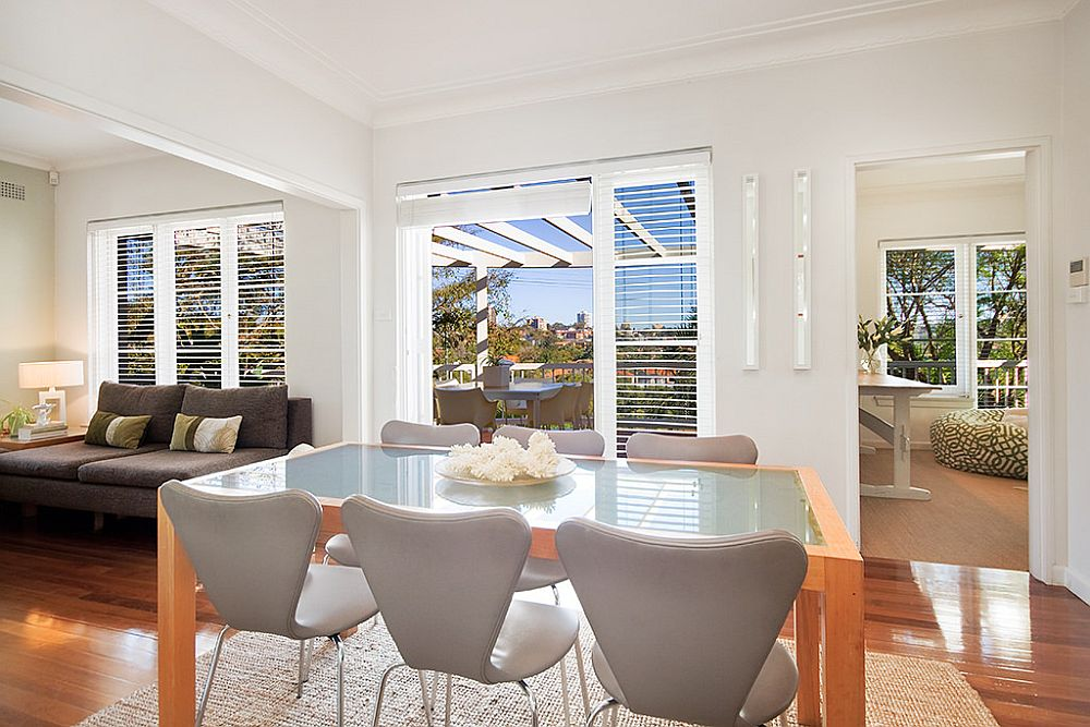 Light-filled dining room of the house is connected with the deck and outdoor dining space