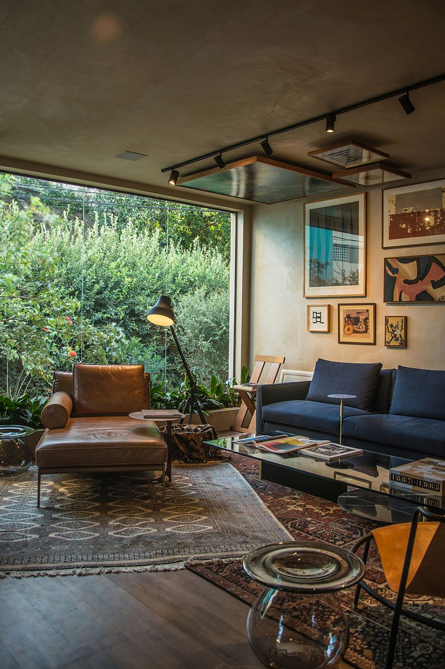 Living room of the stunning home displays stunnin collection of art pieces by various international artists