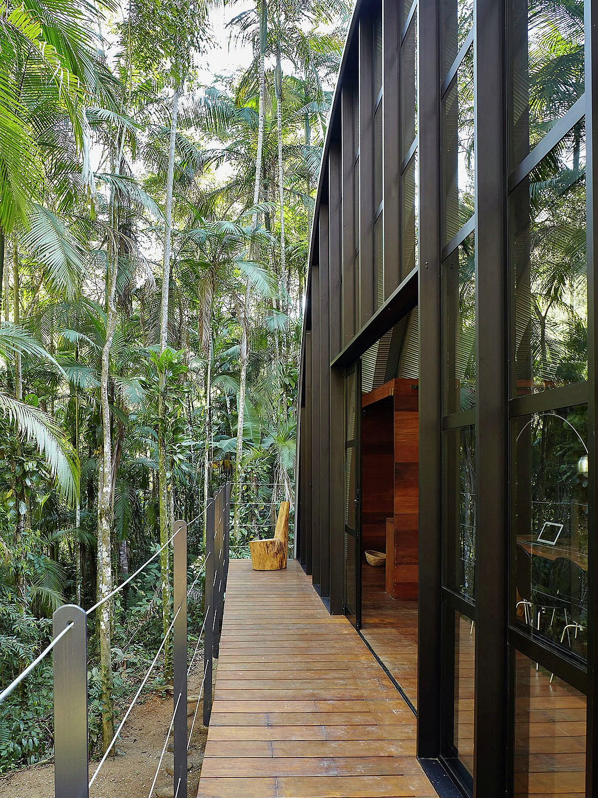 Long balcony of the house offers delightful views of the rainforest around the house