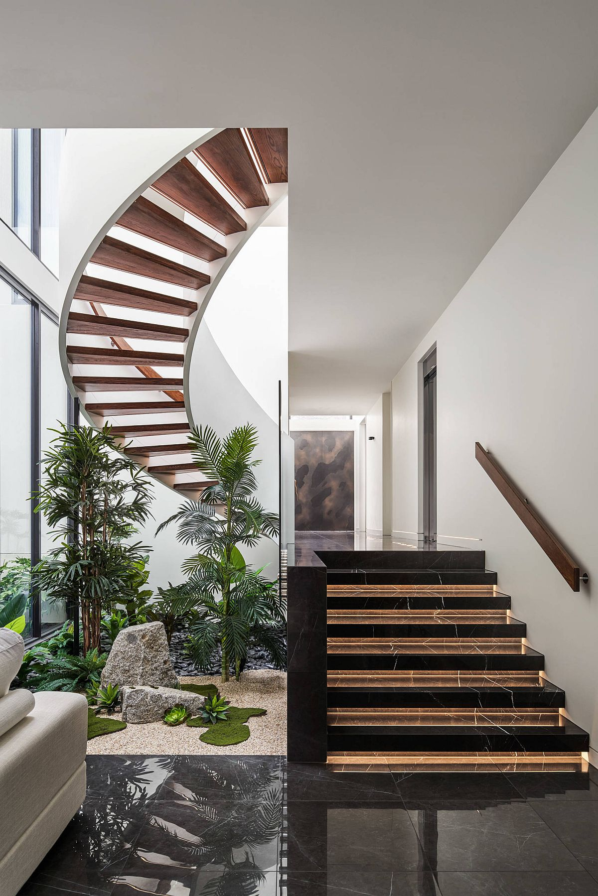 Lovely atrium in green along with a spiral staircase shapes this double-height entry