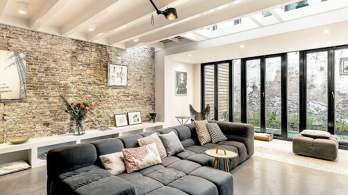 Luxurious sectional on the basement level creates a comfy sitting area