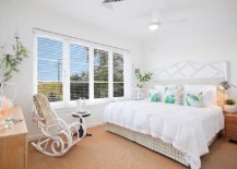 Master-bedroom-of-the-house-in-white-and-wood-has-a-cozy-warm-appeal-and-space-savvy-design-96699-217x155