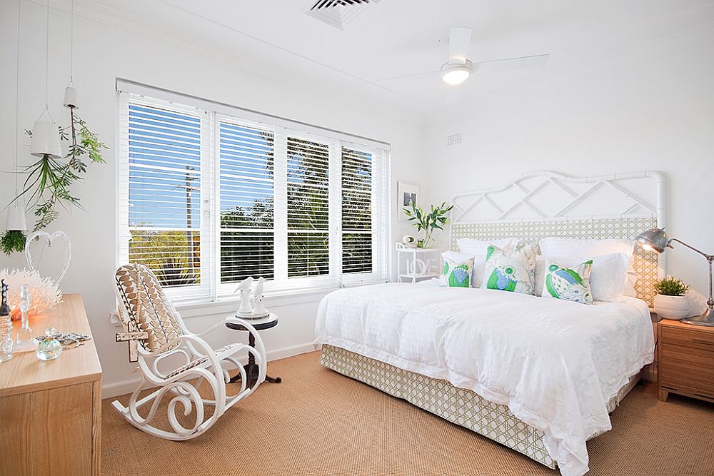 Master bedroom of the house in white and wood has a cozy, warm appeal and space-savvy design