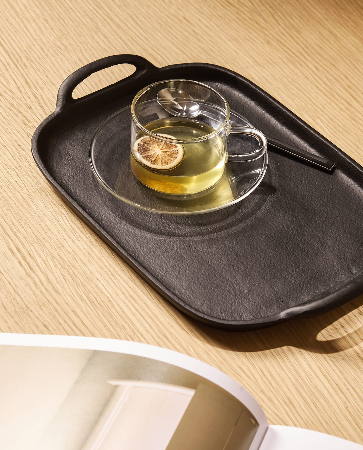 Metal tray with a cup of tea