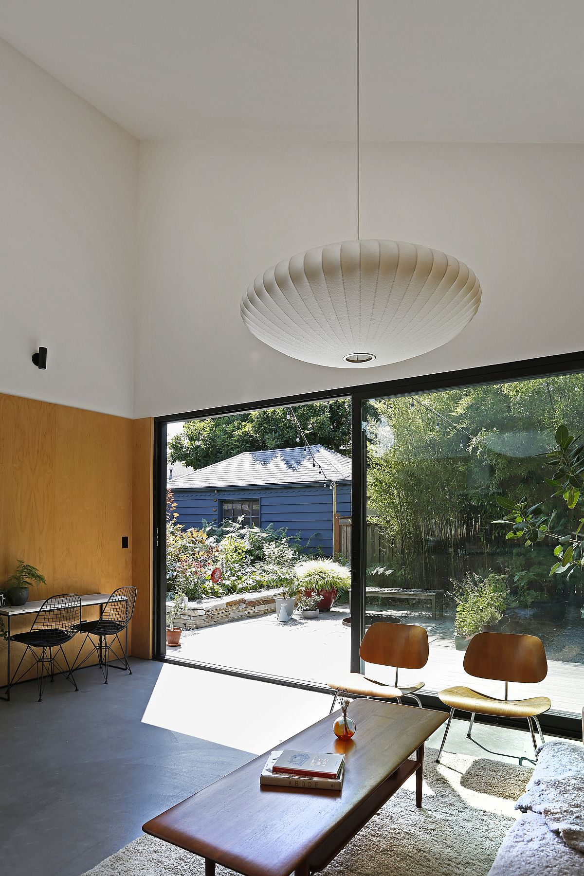 Minimal decor and a space-conscious deisgn give the small living room a larger visual appeal