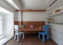 Minimal-play-area-inside-the-small-kids-bedroom-with-a-couple-of-chairs-wooden-shelves-and-ample-space-45356-217x155