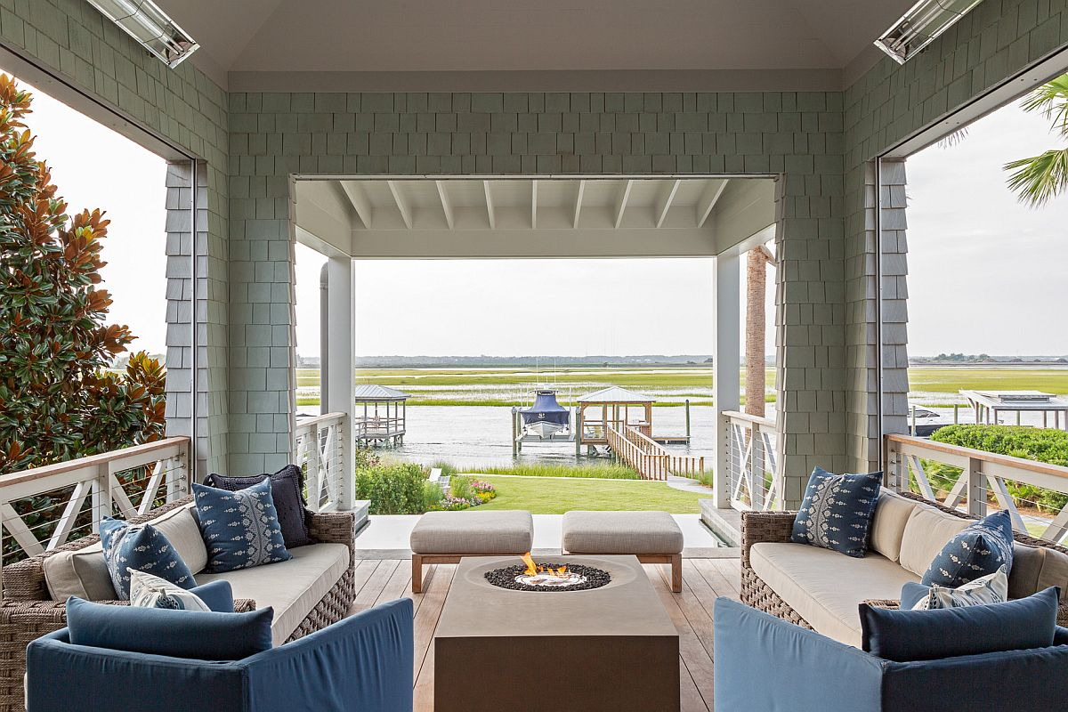 Modern porch with fireplace, blue sofas and ample shade