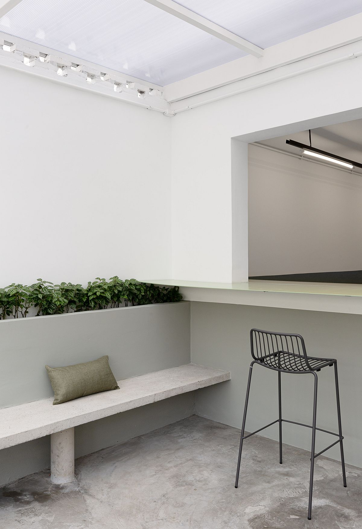 Natural light and greenery bring freshness to the restaurant interior