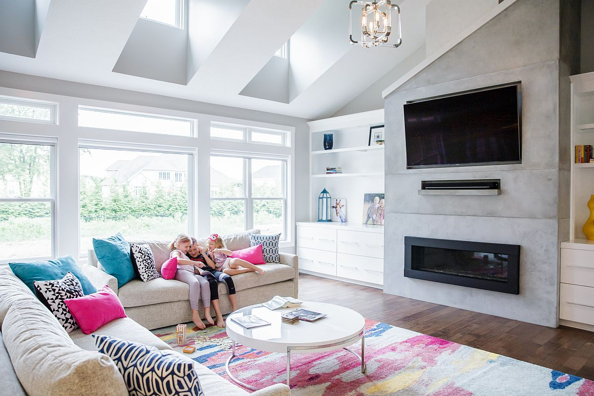 Pink and blue accent pillows for the neutral colored couch